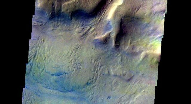 This color image from NASA's 2001 Mars Odyssey released on May 6, 2004 shows the martian surface during the southern summer season in Reull Vallis.