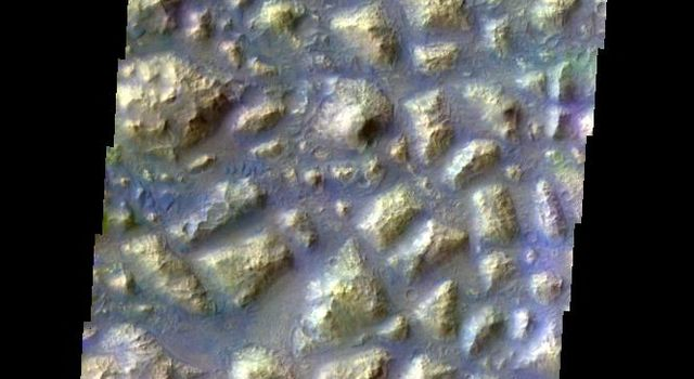 This color image from NASA's 2001 Mars Odyssey released on May 7, 2004 shows the martian surface during the southern summer season in Atlantis Chaos.
