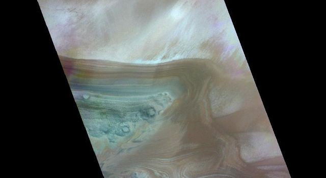 This color image from NASA's 2001 Mars Odyssey released on May 13, 2004 shows the martian landscape during the norther summer season near the south polar cap edge.