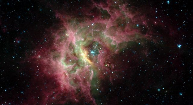 One of the most prolific birthing grounds in our Milky Way galaxy, a nebula called RCW 49, is exposed in superb detail for the first time in this image from NASA's Spitzer Space Telescope.