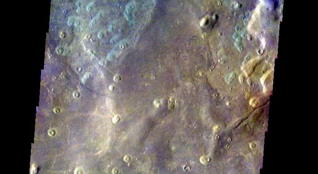 This false-color image released on May 26, 2004 from NASA's 2001 Mars Odyssey of a crater in Acidalia Planitia on Mars was acquired March 8, 2003, during northern summer.