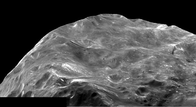 A mosaic of two images of Saturn's moon Phoebe taken shortly after NASA's Cassini spacecraft flyby on June 11, 2004, gives a close-up view of a region near its South Pole.