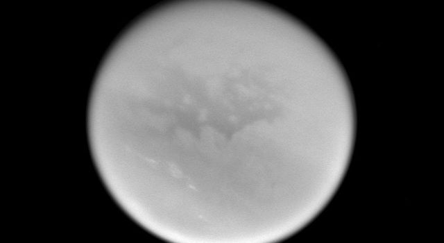 This image captured by NASA's Cassini spacecraft was taken during Cassini's very close approach to Titan on Dec. 13, 2004. Bright streaks of cloud in Titan's southern hemisphere are visible.