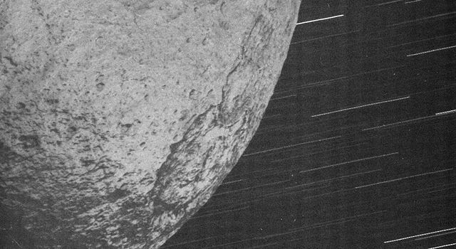 This almost surreal view of Iapetus was acquired by NASA's Cassini spacecraft about 10 minutes after the spacecraft's closest approach to the icy moon during a close flyby on New Year's Eve 2004.