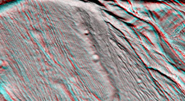NASA's Cassini spacecraft took images of the ropy, taffy-like topography of Saturn's moon Enceladus from many different angles as the spacecraft flew by on Feb. 17, 2005. 3D glasses are necessary to view this image.