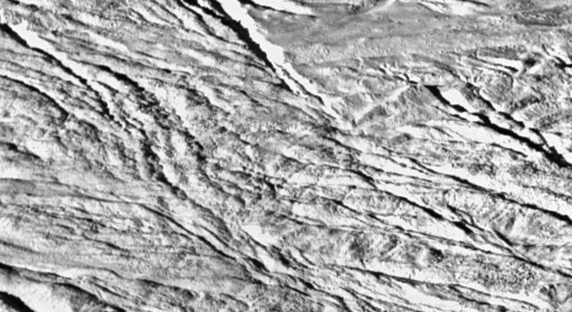 This wide-angle view is one of the highest resolution images yet acquired by NASA's Cassini spacecraft and shows what appears to be a geologically youthful, tectonically fractured terrain.