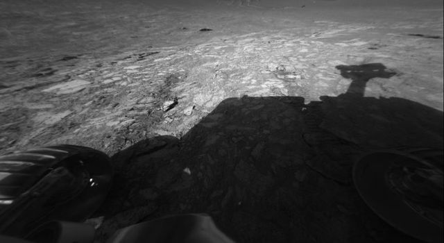 This image from NASA's Mars Exploration Rover Opportunity's front hazard-avoidance camera shows the rover's view of the floor of 'Endurance Crater.' The image was taken from just inside the rim of the crater on June 9, 2004.