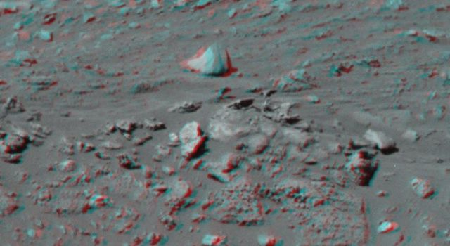 This 3-D image taken by the left and right eyes of the panoramic camera on NASA's Mars Exploration Rover Spirit shows the odd rock formation dubbed 'Cobra Hoods' (center). 3D glasses are necessary to view this image.