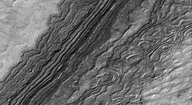This image from NASA's Mars Global Surveyor from Sept. 2005, shows details among some of the eroded layer outcrops of the martian south polar region. Much of the south polar region of Mars is covered by a thick unit of layered material.