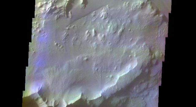 This false-color image released on June 3, 2004 from NASA's 2001 Mars Odyssey was collected December 8, 2002 during southern winter season showing an area of the floor of Ganges Chasma and dark dunes and brighter wind sculpted hills of unknown origin.