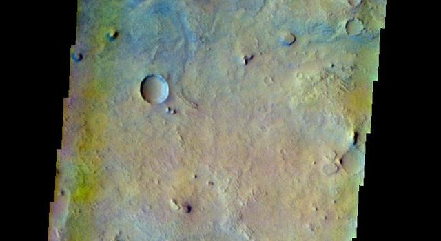 This false-color image released on June 9, 2004 from NASA's 2001 Mars Odyssey was collected June 23, 2002 during northern spring season. The image shows an area in the Nili Fossae region on Mars.