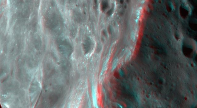 Phoebe's violent, cratered past is evident in this 3D image of the tiny moon captured by NASA's Cassini spacecraft. 3D glasses are necessary to view this image.