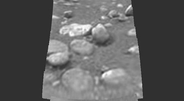 Images from the European Space Agency's Huygens probe descent imager/spectral radiometer side-looking imager and from the medium resolution imager, acquired after landing, were merged to produce this image.