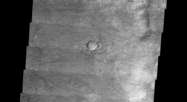 This image released on July 7, 2004 from NASA's 2001 Mars Odyssey shows dust devils have left tracks on the floor of Kaiser Crater on Mars.