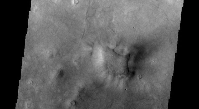 This image released on July 8, 2004 from NASA's 2001 Mars Odyssey shows dust carried aloft by the wind has settled out on every available surface creating sand dunes on Mars.
