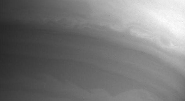 This image from NASA's Cassini spacecraft shows beautifully the complex eddies and wave patterns in Saturn's cloud bands.