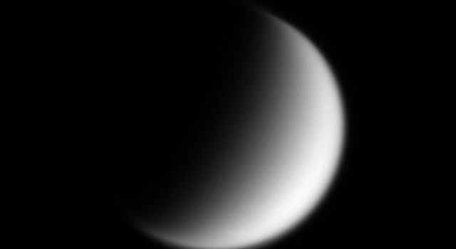 Saturn's planet-sized moon Titan displays a surprisingly flattened-looking north pole in this image captured by NASA's Cassini spacecraft.