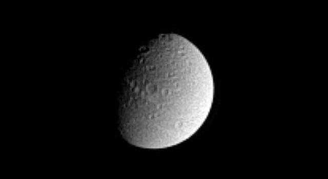 NASA's Cassini spacecraft spied Saturn's crater-covered moon Dione in this image from Dec. 8, 2004.