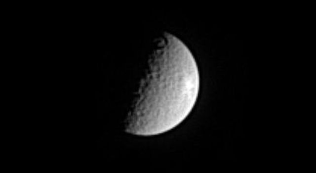 Rhea has been heavily bombarded by impacts during its history. In this image from NASA's Cassini spacecraft, the moon displays what may be a relatively fresh, bright, rayed crater near Rhea's eastern limb.