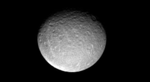 This image captured by NASA's Cassini spacecraft shows predominantly the impact-scarred leading hemisphere of Saturn's icy moon Rhea.