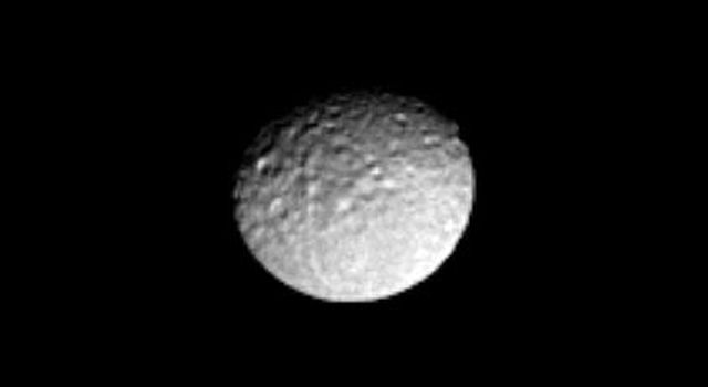 This image captured by NASA's Cassini spacecraft shows Saturn-facing side of icy Mimas, revealing the craters and long linear chasms that cross the moon's surface.