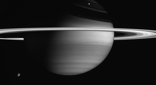 Saturn's biggest and brightest moons are visible in this portrait captured by NASA's Cassini spacecraft.