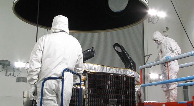 NASA's CloudSat spacecraft sits encapsulated within its Boeing Delta launch vehicle dual payload attach fitting at Vandenberg Air Force Base, Calif.