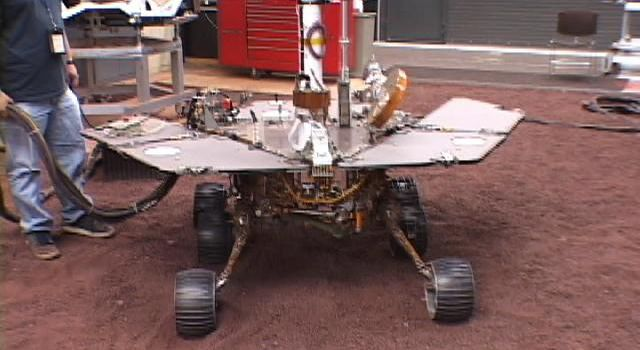 This picture shows a model of NASA's Mars Exploration Rover Spirit being tested for performance on five wheels at NASA's Jet Propulsion Laboratory.