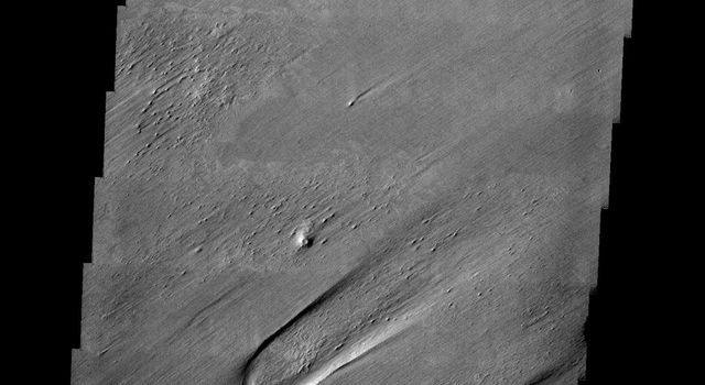 This image released on July 22, 2004 from NASA's 2001 Mars Odyssey shows that eons of atmospheric dust storm activity has left its mark on the surface of Mars such as wind eroded landforms that can be covered by later materials.