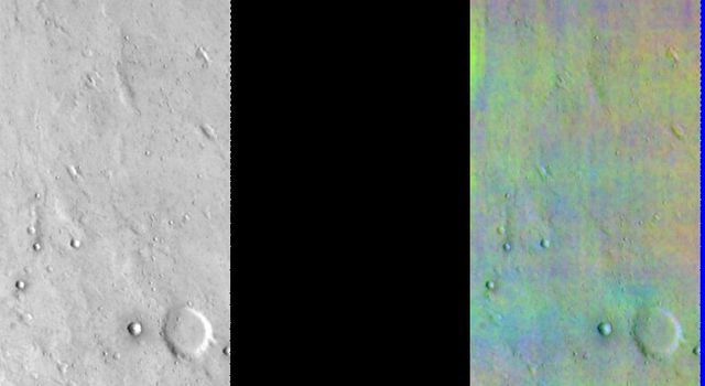 This image released on July 26, 2004 from NASA's 2001 Mars Odyssey shows a decorrelation stretch near Ganges Chasma. Pink/magenta colors usually represent basaltic content, cyan indicates the presence of water ice clouds, while green can represent dust.