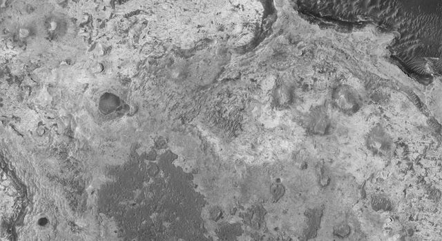 NASA's Mars Global Surveyor shows small buttes formed of eroded sedimentary rock, in northern Sinus Meridiani on Mars.