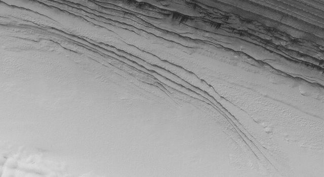NASA's Mars Global Surveyor shows an unconformity in the layered sequence of the martian north polar cap. An unconformity is a geologic term that indicates a break in the depositional record of a sedimentary deposit.