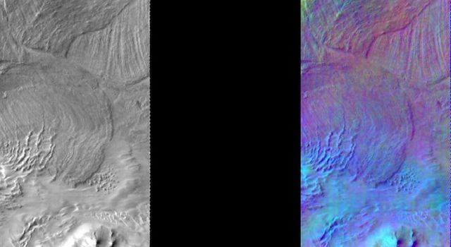 This image released on August 11, 2004 from NASA's 2001 Mars Odyssey shows a decorrelation stretch over Melas Chasm. Pink/magenta colors usually represent basaltic dunes, cyan indicates the presence of water ice clouds, while green can represent dust.