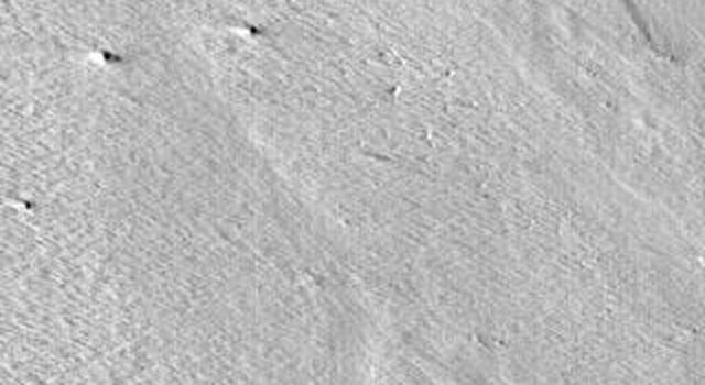 This image released on August 26, 2004 from NASA's 2001 Mars Odyssey shows Gordii Dorsa, one of the largest ridges on Mars. Dorsa mean ridge; Gordii means Gordian knot.