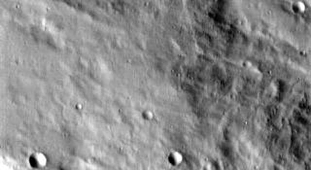 This image released on August 27, 2004 from NASA's 2001 Mars Odyssey shows Scylla Scopulus, an irregular scarp located in the southern highlands of Mars. Scolupus is a lobate of irregular scarp.
