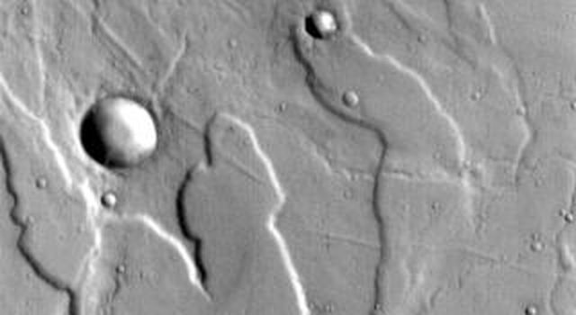 This image released on Oct 13, 2004 from NASA's 2001 Mars Odyssey shows Tyrrhena Patera and its surroundings. Tyrrhena Patera is one of several moderate sized volcanoes located in the Martian southern highlands.