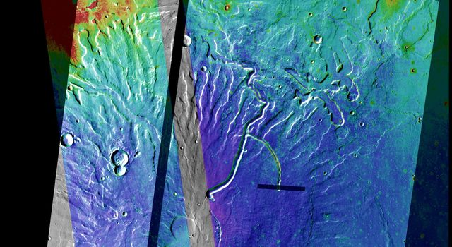 This false-color image released on Oct 15, 2004 from NASA's 2001 Mars Odyssey shows Tyrrhena Patera on Mars colorized with a mosaic of nighttime temperature images (purple/blue is coldest, yellow/red is warmest).