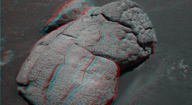 This anaglyph from NASA's Mars Exploration Rover Opportunity shows an unusual, lumpy rock informally named 'Wopmay' on the lower slopes of 'Endurance Crater.' 3D glasses are necessary to view this image.