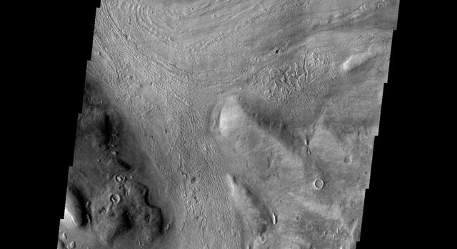 This image released on Oct 20, 2004 from NASA's 2001 Mars Odyssey shows Reull Vallis, located in the Martian southern highlands, just east of Hellas Basin.