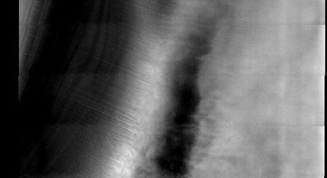 This image released on Oct 25, 2004 from NASA's 2001 Mars Odyssey shows the Martian north polar cap. Streamers of dust moving downslope over the darker trough sides showing the laminar flow regime coming off the cap.