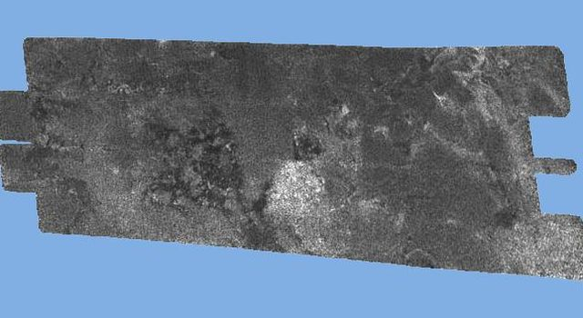 This radar image of the surface of Saturn's moon Titan was acquired on October 26, 2004, when NASA's Cassini spacecraft flew over. Brighter areas may correspond to rougher terrains and darker areas are thought to be smoother.