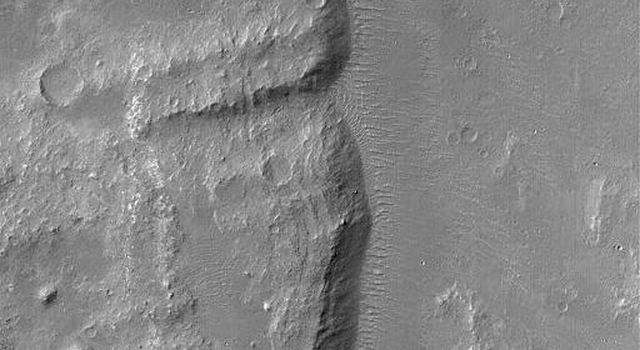 NASA's Mars Global Surveyor shows the distal (far) end of a landslide deposit in Coprates Chasma, part of the vast Valles Marineris trough system on Mars. Large boulders, the size of buildings, occur on the landslide surface.