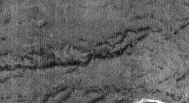 This night time image released on Nov 22, 2004 from NASA's 2001 Mars Odyssey shows Parana Vallis, one of many channels located in the Martian highlands SE of Eos Chasma (the eastern end of Valles Marineris).