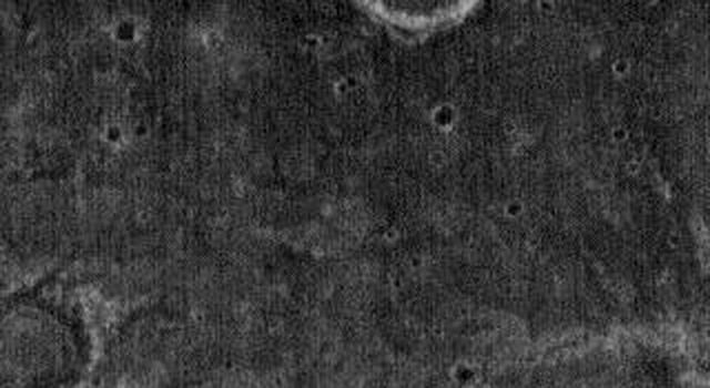 This night time image released on Nov 24, 2004 from NASA's 2001 Mars Odyssey shows a small unnamed channel on Mars located near Tyrrhena Patera. This channel is located to the northwest of the volcanic complex and likely formed by fluvial action.