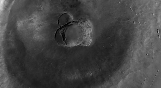 NASA's Mars Global Surveyor shows Ascraeus Mons, the northernmost of the three Tharsis Montes shield volcanoes on Mars.