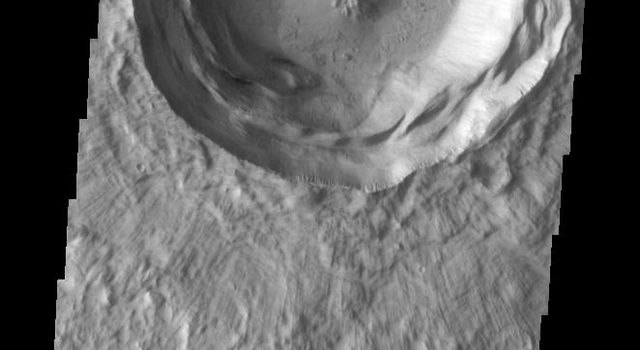 This image from NASA's Mars Odyssey shows a beautiful example of a central peak crater on Mars. Note also the slumped interior crater walls and the well defined lobes of the ejecta blanket. This crater is located in the Isidis basin.