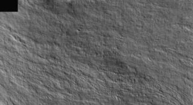 This image from NASA's Mars Odyssey shows a portion of the flank of Olympus Mons on Mars. Lava flows are easily identifiable in this image.