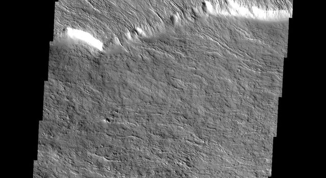 This image from NASA's Mars Odyssey shows a portion of the flank of Olympus Mons on Mars. Many flows have a central channel with raised edges and are fairly narrow.