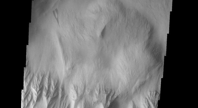 This image from NASA's Mars Odyssey shows landslide in this image originating from the steep escarpment which surrounds the Olympus Mons volcano on Mars. This landslide is located on the northern side of the volcano.