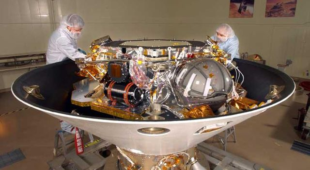 The Phoenix lander, housed in a 100,000-class clean room at Lockheed Martin Space Systems' facilities near Denver, Colo. Shown here, the lander is contained inside the backshell portion of the aeroshell (with the heat shield removed).